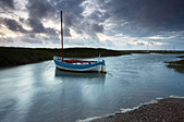 A moody and windy summer evening at Brancaster Staithe, North Norfolk, England, United Kingdom, Europe - Stock Image - CFDRPY