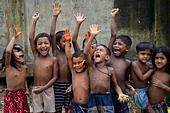 Dhaka, Bangladesh. 22nd July, 2015. A group of Bangladeshi slum children are enjoying at Agargaon slum in Dhaka city, Bangladesh.On July 22, 2015 Bangladeshi slum child at Agargaon slum in Dhaka. More than half of the populations of city slums are children. They face hardship on a daily basis that includes hunger, poor access to clean water, health care, insufficient education and protection. © Mamunur Rashid/Alamy Live News - Stock Image - EY69YM