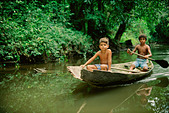 Boys in canoe in a small river in Tropical Rain Forest Amazon Region Para Brazil - Stock Image - A3N0PR