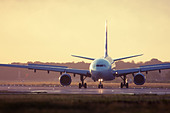 Commercial airliner at London Gatwick Airport runway, England, United Kingdom - Stock Image - DNKEWM