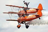 Breitling Wingwalkers British aerobatics and wingwalking team performing at Farnborough Airshow 2012, UK - Stock Image - D58437