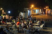 People sitting at an outdoor bar on a square in Trinidad, Cuba, Caribbean, Latin America - Stock Image - EM4X7K