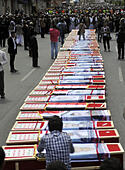 Sanaa, Yemen. 14th Oct, 2014. Supporters of the Shiite Houthi group stand around coffins of the victims who were killed last week in a suicide bomb attack in Sanaa, Yemen, on Oct. 14, 2014. The Shiite Houthi group held a funeral for those who were killed last week in the suicide bomb attack that targeted a Houthi protest rally and left at least 47 people killed, in Sanaa on Tuesday. © Hani Ali/Xinhua/Alamy Live News - Stock Image - E8TWY7