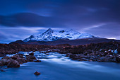 A moody twilight with aplen glow in the Cuillin Hills on the Isle of Skye, Scotland - Stock Image - C6RRJ7
