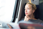 Lady traveling by train. - Stock Image - E2C0J8
