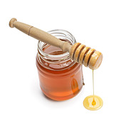 Jar of honey with drizzler - Stock Image - B3058E