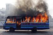"Dhaka, Bangladesh. 30th Oct, 2014. A Bangladeshi activist set fire on the bus Awami during the country wide strike in Dhaka, Bangladesh, 30 October 2014. Jamaat-e-Islami strike called to protest the death sentence of its chief Motiur Rahman Nizami convicted on war crimes charges. Jamaat has called 24-hour strikes on Thursday, Sunday and Monday after its chief, who headed the notorious """"˜killing squad', Al-Badr, during the 1971 Liberation War, was sentenced to death by the International Crimes Tribunal on Wednesday. © ZUMA Press, Inc./Alamy Live News - Stock Image - E9MKJ9"