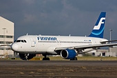 Finnair Airbus A320-214 taxiing for departure at London Heathrow Airport, United Kingdom - Stock Image - B8F1DR