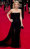 epa04702158 US actress Gillian Anderson arrives for the 39th annual Olivier Awards at The Royal Opera House in London, Britain, 12 April 2015. The theatre awards is named after British actor Laurence Olivier.  EPA/HANNAH MCKAY - Stock Image - EM1RKM