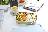 Bento box (Lunch box) on a desk - Stock Image - BM3385