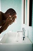 Male washing face - Stock Image - BJPR69