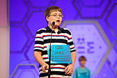 """National Harbor, USA. 27th May, 2015. Joel Miles, 12, a sixth grader at Eagle Glen Intermediate School in Raymore, Mo., reacts to the bell after misspelling """"seriema"""" and being disqualified in round three - one of the preliminary rounds - of the 2015 Scripps National Spelling Bee being held at the Gaylord National Resort and Conference Center on May 27, 2015 in National Harbor, Md. © Allison Shelley/McClatchy DC/TNS/Alamy Live News - Stock Image - ER6N6K"""