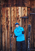 Man standing with skis and poles - Stock Image - CR2129