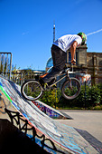 BMX biker performing tricks on a ramp - Stock Image - C3NGDN