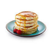 Pancakes with raspberries and maple syrup - Stock Image - AY2DYR