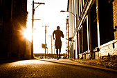 African American man jogging - Stock Image - CPD8F7