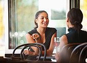 Asian friends sitting together in cafe - Stock Image - D2PRD7