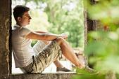 Man sitting in windowsill - Stock Image - CWWENC