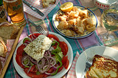 Greek salad,calamares and saganaki served 'alfresco' - Stock Image - B0E6E6