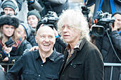 Basing Street, London, UK. 15th November 2014. Artists arrive at Sarm Studios in Notting Hill, west London, to record Band Aid. Pictured: Midge Ure and Bob Geldof greet the crowd outside Sarm Studios. © Lee Thomas/Alamy Live News - Stock Image - EAJ2XH