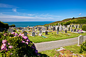 Cemetery at Morthoe overlooking Bristol Channel and Lundy Island, near Woolacombe, north Devon, England, UK - Stock Image - C67GGK