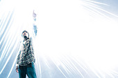 African American man pointing at light spark - Stock Image - C6E1H6