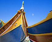 MT - MALTA: Typical Maltese Boats at Marsaxlokk Harbour - Stock Image - A0MG44