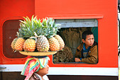 A woman selling fruit, a boy looking out of the window of a train, Hispaw, Shan State, Myanmar, Burma, Asia - Stock Image - BH0JPE