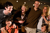 Young friends hanging out and drinking at bar together - Stock Image - B720E6