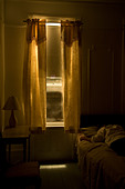 interior hotel room , man sleeping, monochromatic - Stock Image - BT2R60