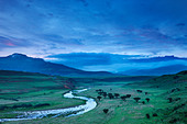 a moody evening sky over the Tugela Valley with the Drakensberg Mountains beyond, KwaZulu Natal, South Africa - Stock Image - B9NRYJ