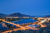 Sage brush creates the foreground for a dynamic dusk scene over Kamloops, British Columbia, Canada - Stock Image - CFAT1E