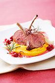 Lamb chops with pumpkin puree and cranberry sauce - Stock Image - BJME8P