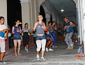 Cuban teenagers, youth, dancing on the street night time. Cienfuegos, Cuba, November 2010 - Stock Image - CWJXHB