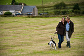 Happy married couple walking and enjoying their country lifestyle, Cumbria, uk - Stock Image - BJ66TM