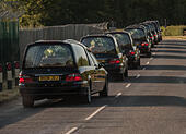 RAF Brize Norton, Oxfordshire, UK. 2nd July, 2015. The second set of coffins of the victims of the massacre on the beach in the Tunisian resort of Sousse, Tunisia on Friday 26th June 2015 departs from RAF Brize Norton headed for London Credit: © Desmond Brambley/Alamy Live News - Stock Image - EWY980