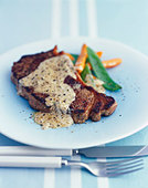 Beef steak with pepper cream sauce - Stock Image - BJJC4C