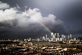 London, UK. 12th Nov, 2014.  Rainbow over Canary Wharf business buildings © Guy Corbishley/Alamy Live News - Stock Image - EAD149