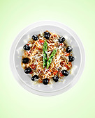 Spaghetti with black olives and asparagus indicating lunch time of one o'clock. - Stock Image - BFBH2R
