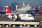 Regional airliner Swiss International Air Lines BAE Systems Avro 146-RJ100 at London City Airport, England, UK - Stock Image - CYHHXA