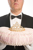 Butler Holding a Tiara on a Cushion - Stock Image - BDJCHE