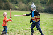 Battle Abbey, East Sussex, UK. 11th October 2014. Approximately 400 soldiers took part in a re-enactment of the 1066 Battle of Hastings at Battle Abbey in East Sussex between King Harold's Saxons and William the Conquerer's Normans. Pictured:  Two boys decide to have their own battle. © Lee Thomas/Alamy Live News - Stock Image - E8NC9A
