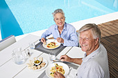Spain, Senior couple having lunch at Mallorca - Stock Image - D21JAC