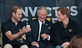 epaselect epa04395836 Britain's Prince William, Duke of Cambridge (L), Prince Charles, Prince of Wales (C) and Prince Harry (R) attend the athletics competition of the Invictus Games, in London, Britain, 11 September 2014. More than 400 competitors from 13 nations will take part in the multi-sport event which will run from 10 to 14 September. The Invictus Games are an international sporting event for wounded, injured and sick Servicemen and women and are championed by Prince Harry.  EPA/WILL OLIVER - Stock Image - E7D2KC