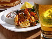 Shrimp entree and glass of beer - Stock Image - CBTFRW