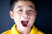 Boy with Mouth Open - Stock Image - CCAF80