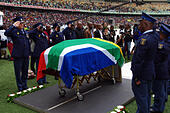 Durban, South Africa. 1st November, 2014. An honour guard of the South African Police Services salute as the national anthem is played at the funeral of slain South African soccer captain Senzo Meyiwa in Durban's Moses Mabhida Stadium. Meyiwa, who was also the goal keeper for Orlando Pirates, was gunned down in Vosloorus a week earlier. © Giordano Stolley/Alamy Live News - Stock Image - E9RHB1