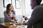 Couple enjoying lunch at bistro table - Stock Image - E3R5TM