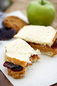 Partially Eaten Peanut Butter and Jelly Sandwich on White Bread, Bagged Lunch - Stock Image - BJM5H4