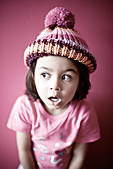 Girl in pink with bobble hat - Stock Image - AA93GW